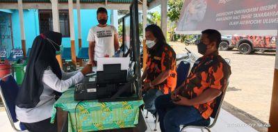 Ketua MPC PP Rohul Syahmadi Malau Terima Vaksinasi Perdana di Puskesmas Rambah